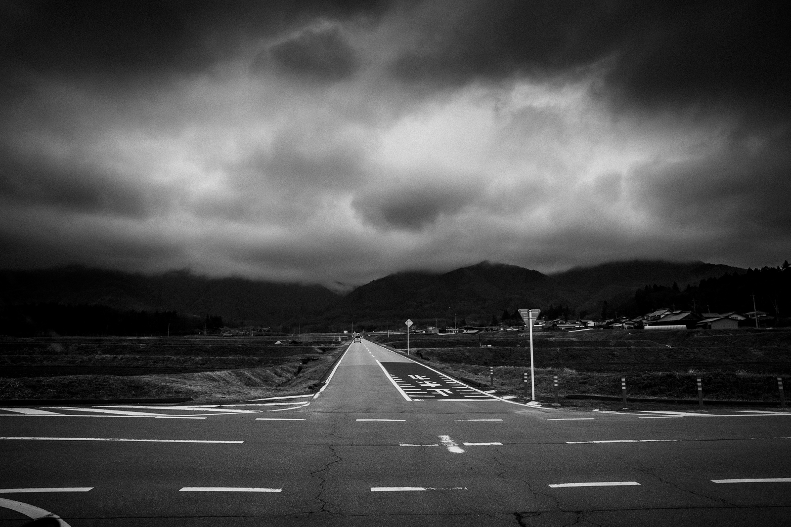 Dark clouds over a road in Yamanashi Prefecture, Japan. Photo by David R Munson
