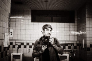 Yours truly a few years back, taking one of those iconic mens-room selfies