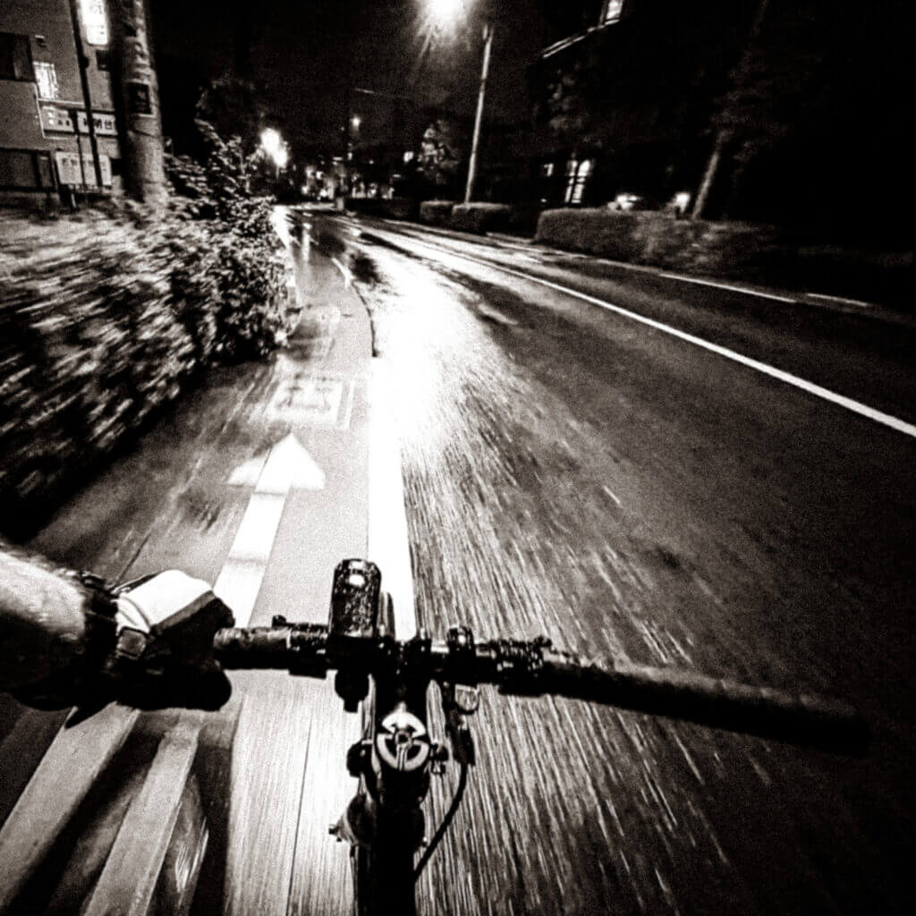 Cycling one evening after work in a light rain