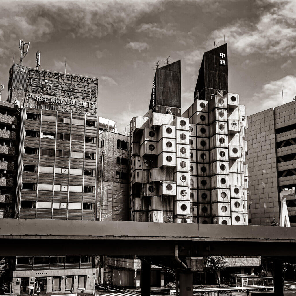 View of Nakagin Capsule Tower in Ginza, Tokyo, as seen from across the elevated highway